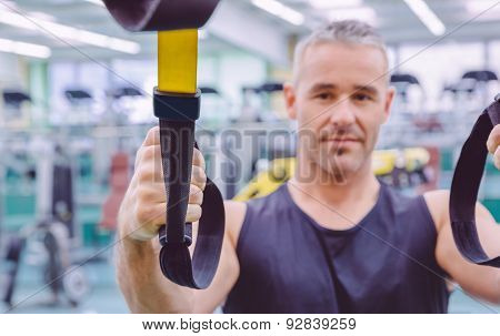 Fitness strap in the hand of man training