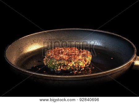 Frying Seasoned Hamburger In Fry Pan Isolated On Black