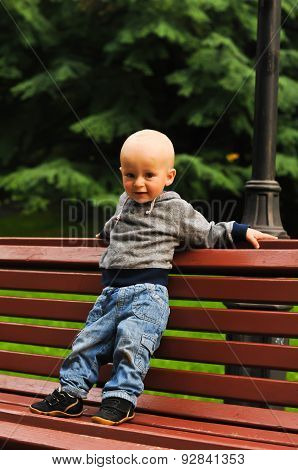 Little Child Stands On Bench