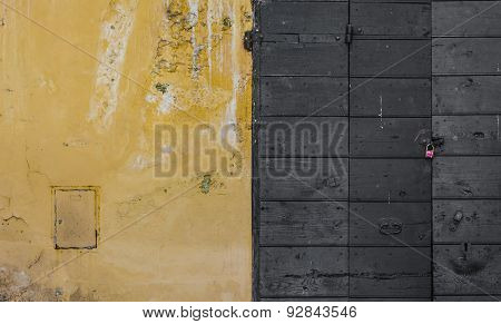 Scraped Wall And A Wooden Door