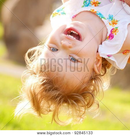 Happy Baby Playing Upside Down.
