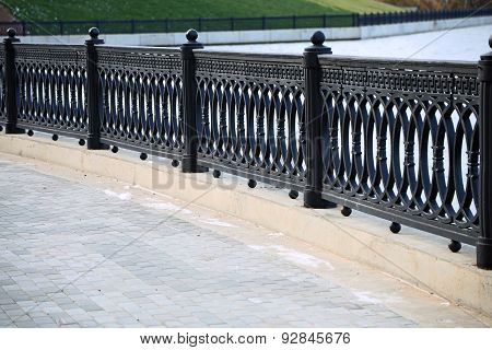 Cast Iron Grate Fence On The Embankment