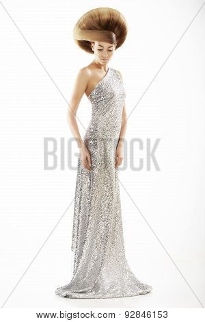 Vogue Style. Trendy Woman In Silver Silky Dress And Creative Hairstyle