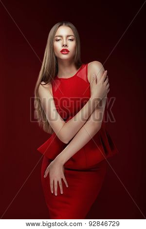 Elegance. Stylish Lady In Red Silky Dress