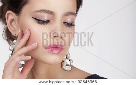 Young Thinking Female With Shiny Earrings