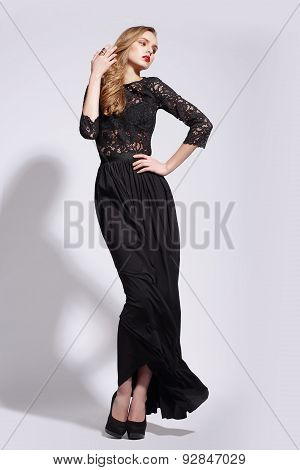 Elegant Luxurious Woman Posing In Long Dress