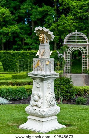 Image Of An Old Sundial With A Gazebo In The Background In A Mansion Garden