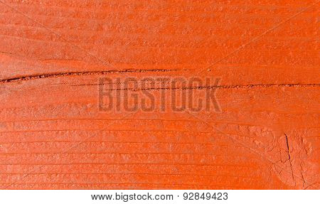 Wooden background texture uneven with lines and ridges red brown in colour