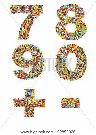 Numbers 7 Through 0 And Punctuation Marks Made From Colorful Glass Beads On A White