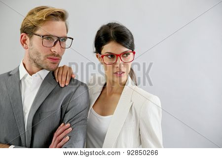 Business couple standing on grey background, isolated