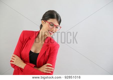 Beautiful brunette girl with red jacket and eyeglasses, isolated