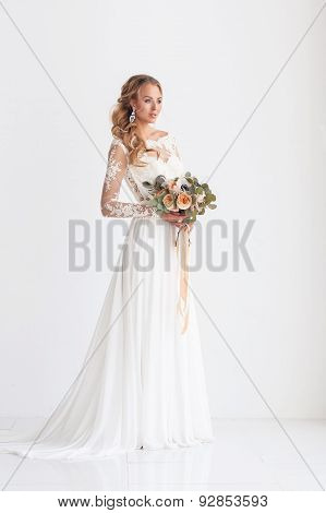 Young attractive bride with a wedding bouquet