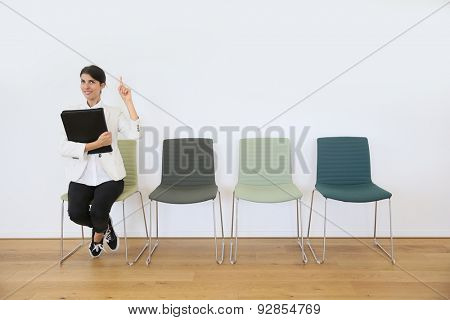 Woman sitting on chair waiting for job interview