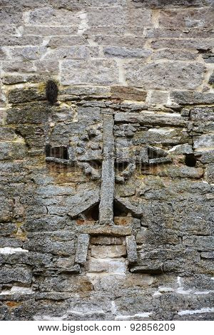 Cross On The Wall Of The Izborsk Fortress. Pskov Region. Russia