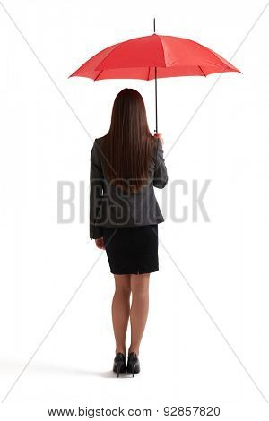 back view of woman in formal wear under red umbrella. isolated on white background