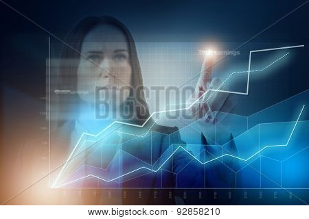 businesswoman using the virtual screen with graph