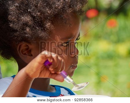 Adorable Black African Baby Eating