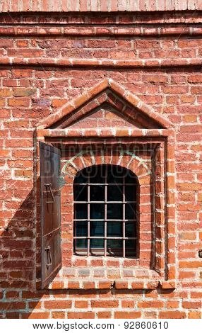 Old window in brick wall - Krutitskoe Compound Cathedral in Moscow Russia