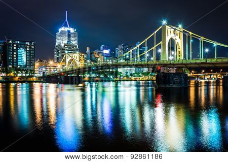 The Pittsburgh Skyline And Roberto Clemente Bridge At Night, Seen From The North Shore In Pittsburgh