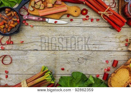 Rhubarb - fresh rhubarb on a wooden background, frame