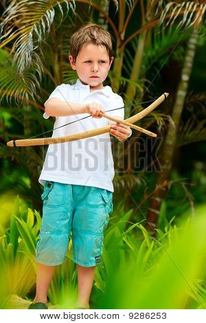 Cute Boy Playing With Bow And Arrows