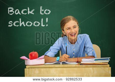 Back to school - beautiful schoolgirl in the classroom