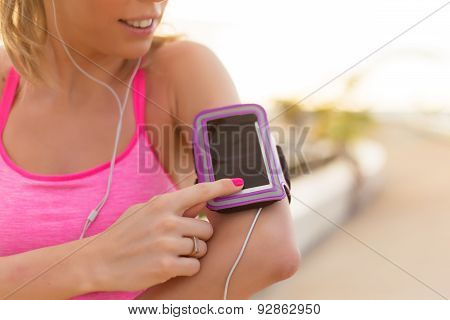 Woman using sports activity tracking app on her mobile phone