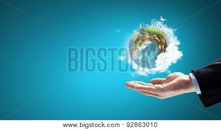 Close up of hand holding Earth planet. Elements of this image are furnished by NASA