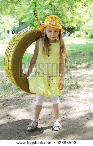Girl Standing Near Tire Swing