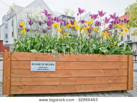 Sign by stone toll bridge on flower pot
