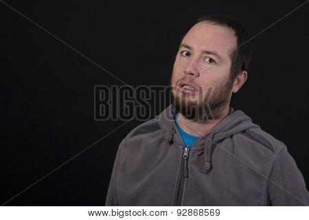 Sad Man Isolated On Black Background
