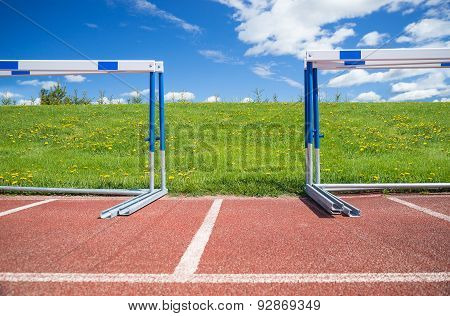 Hurdles Stacked At The Edge Of Athletics Race Track On A Sunny Summer Day