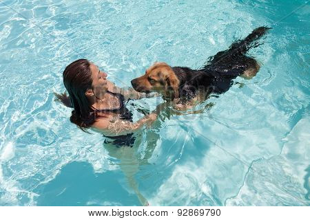 Woman Swimming With Dog