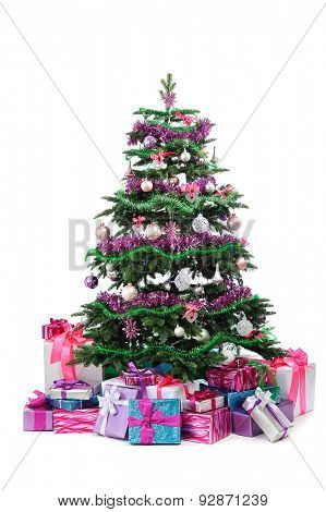 decorated Christmas tree with heap of gifts isolated on white background