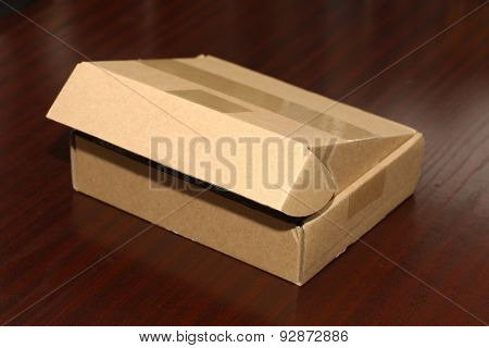 Open cardboard box on a table