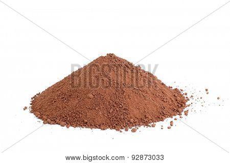 Cocoa powder pile on white background