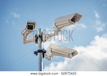 Security cctv surveillance camera in front of blue sky concept for counter-terrorism, antiterrorism and protection from crime