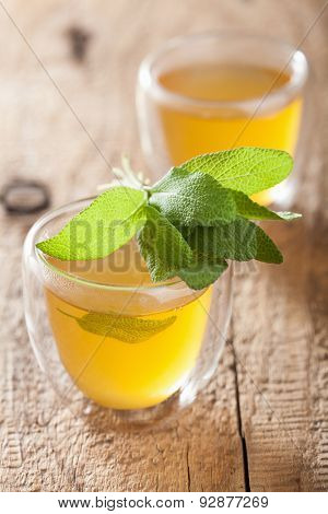 herbal sage tea with green leaf in glass cup