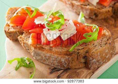 italian bruschetta with tomatoes parmesan rucola