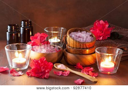spa aromatherapy with azalea flowers and herbal salt on rustic dark background