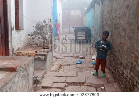 Indian Boy On The Street Cold Foggy Winter Morning In Varanasi