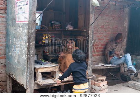 Indian Small Tea Shop On The Ghat At Cold Foggy Winter Morning. Varanasi