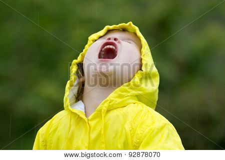 Young girl playing in rain