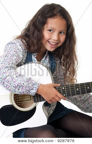 Girl Plays The Guitar