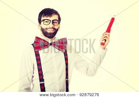 Funny man wearing suspenders pointing up with big pencil.