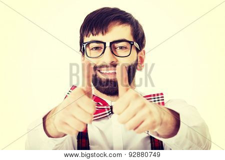 Funny handsome man wearing suspenders with ok sign.