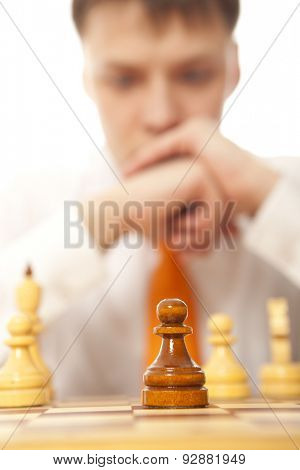 Teamwork. Young business man playing chess