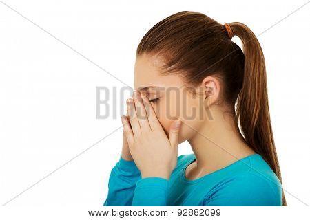 Teen woman suffering from sinus pressure pain.