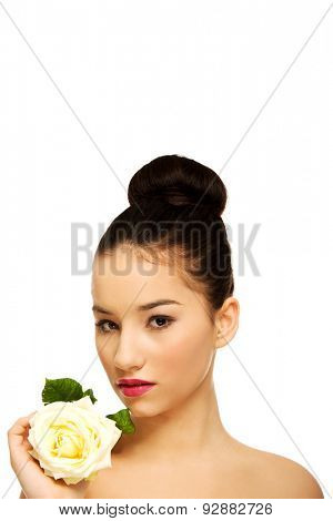 Sensual spa woman with white rose.
