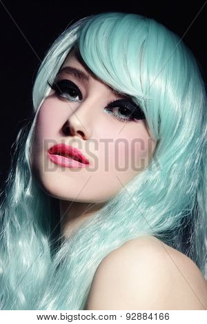 Portrait of young beautiful girl in fancy cosplay wig